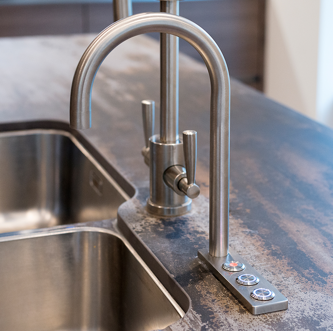 Quatreau SmartTap boiling, chilled and sparkling tap fitted over a kitchen sink