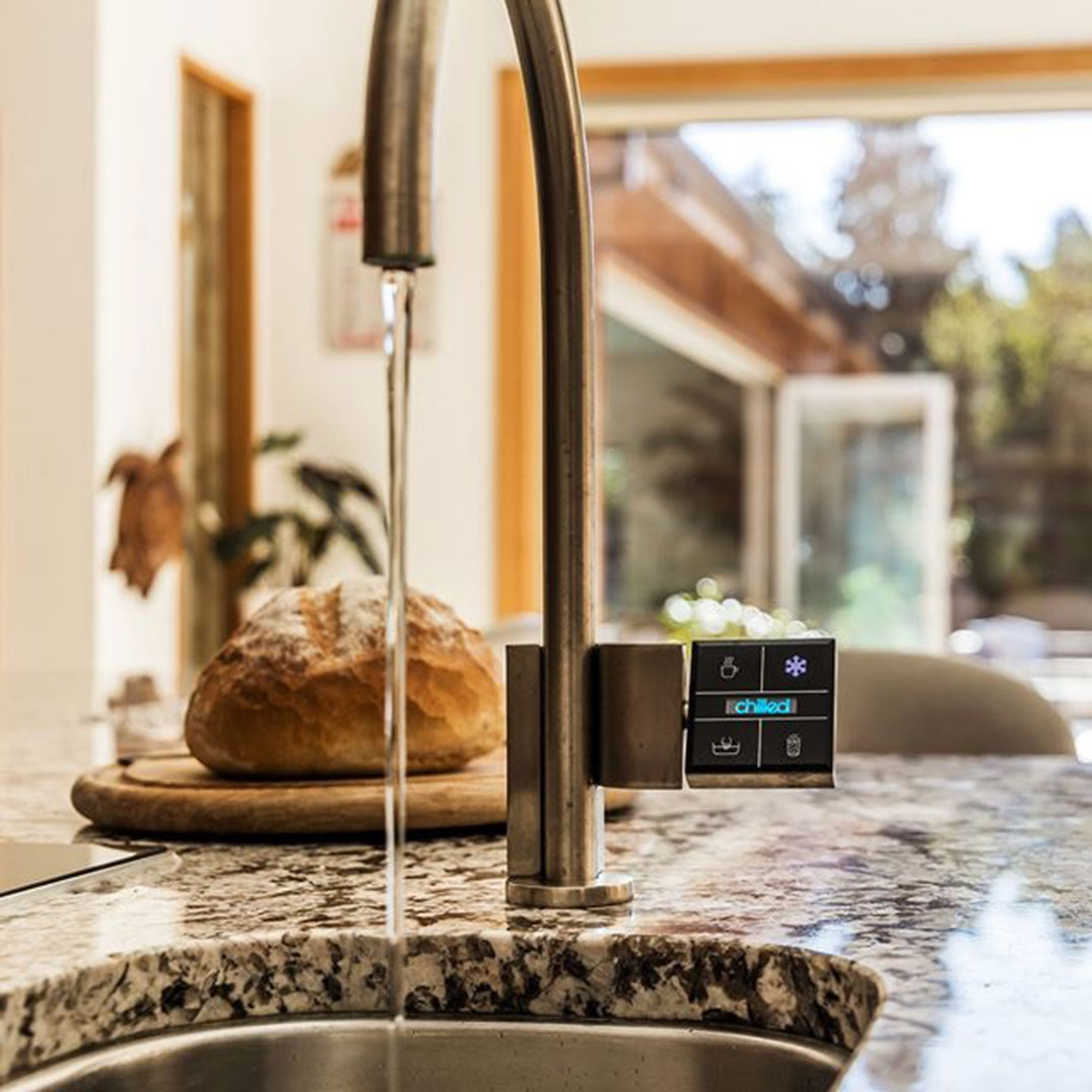 Quatreau touchscreen kitchen tap in brushed stainless steel finish in domestic kitchen